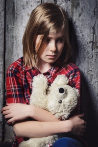 Depressed child with toy