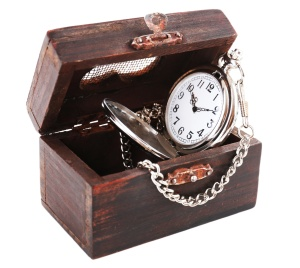 Silver pocket clock in wooden box isolated on white