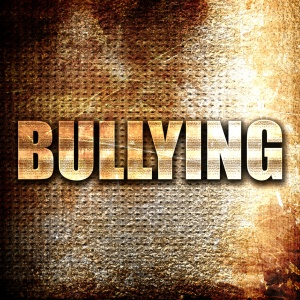 bullying, written on vintage metal texture